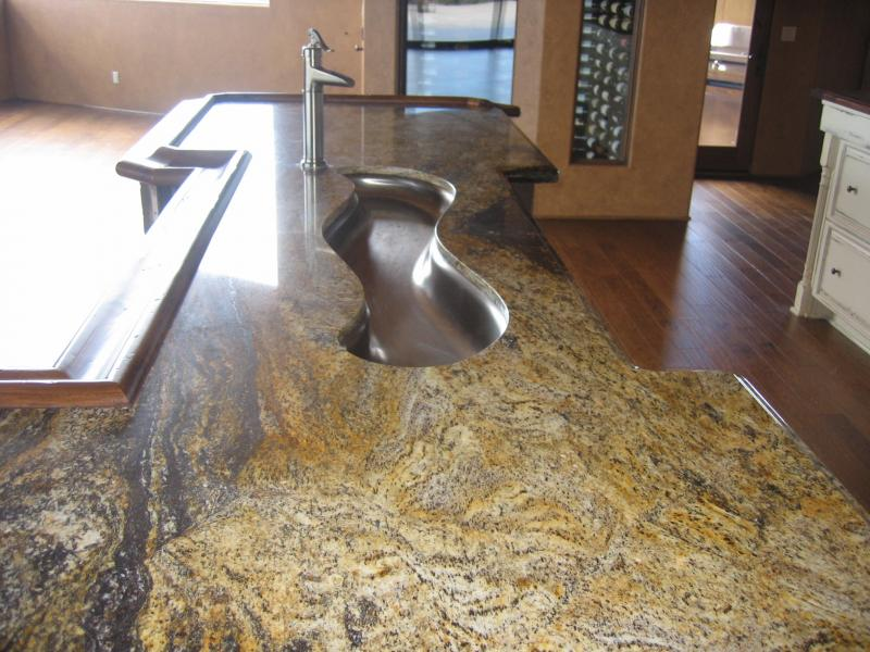 Detailed contouring granite to a river sink